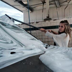 Washing car with car washing brush