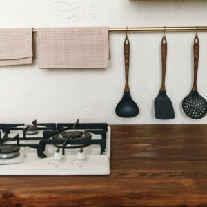 Kitchen wooden countertop with hob and kitchenware